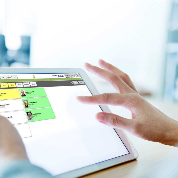PointClickCare's eMAR product being used on tablet device